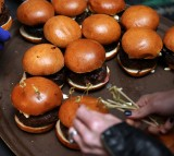 Burgers are prepared during the Blue Moon Burger Bash.