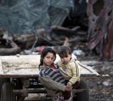 Palestinian children pose for a photo in a poverty-stricken quarter.