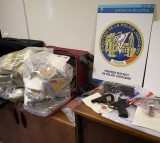 About 41 kgs of cocaine and weapons are displayed at the police headquarters on January 14, 2016 in Paris.