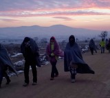 Migrants try to keep warm as they cross the Macedonian-Serbian border in early morning sub zero temperatures.