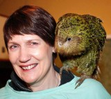 New Zealand Prime Minister Helen Clark carries on her shoulder an 11-week-old kakapo chick named Marama.