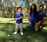 Sam Blewett 'The Little Aussie Golfer' poses with his parents Greg and Katheryn duing a portrait session on November 27, 2016 in Adelaide, Australia.