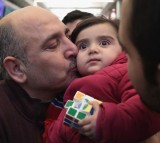 Syrian Refugee Family Arrives In U.S. As Immigration Ban Is Debated In Court