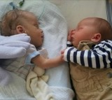 Critically Ill Baby Boy Holds Twin's Hand