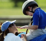 Austistic Boy with Cerebral Palsy Undergoes Horse Therapy