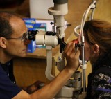 An eye exam is performed at the Remote Area Medical (RAM) clinic at the Los Angeles Sports Arena on April 27, 2010 in Los Angeles, California.  Meanwhile in the UK, Oxford Eye Hospital successfully pe
