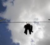Effigy Of Wall Street Banker Hangs By Freeway In Miami