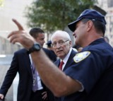 An NYPD officer with forner Vice-President Dick Cheney