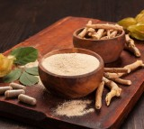 Roots and powder of Ashwagandha also known as Indian ginseng on wooden background.