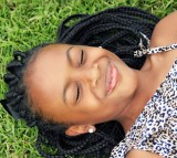 Girl Face African Girl Laying Down Outdoors Happy