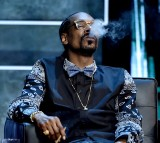 Rapper Snoop Dogg appears onstage at the Comedy Central Roast of Justin Bieber.
