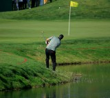 Marc Leishman of Australia and the International team plays his fifth shot from the hazard.