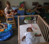 Four-month-old Joaquin naps in the baby room at the federally-funded Head Start school on September 20, 2012 in Woodbourne, New York.