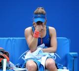 Alize Cornet of France shows her frustration against Christina McHale of USA.