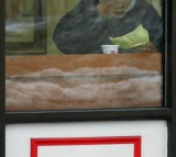 A patron eats his burger in a McDonald's fast-food restaurant on January 26, 2005 in Chicago, Illinois.