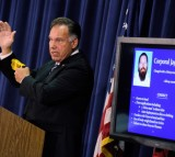 Orange County District Attorney Tony Rackauckas uses a taser gun to demonstrate how Fullerton police officer used his weapon during a confrontation with Kelly Thomas, a schizophrenic homeless man.