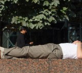A city worker takes a nap in the sun.