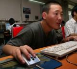 Mongolians play computer games at an Internet cafe July 15, 2003 in Ulan Bator, Mongolia.