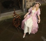 Sleeping Beauty, played by actress Elisabeth Knoche, reclines in her 100-year sleep after she pricked her finger on a spindle at Sababurg Palace on November 18, 2012 near Hofgeismar, Germany.