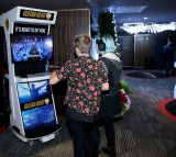 Guests play Guitar Hero during 106.7 KROQ Almost Acoustic Christmas 2015.
