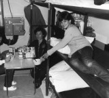 Phyllis Millet and her daughters Roberta and Katie (right) have breakfast in their underground nuclear shelter.